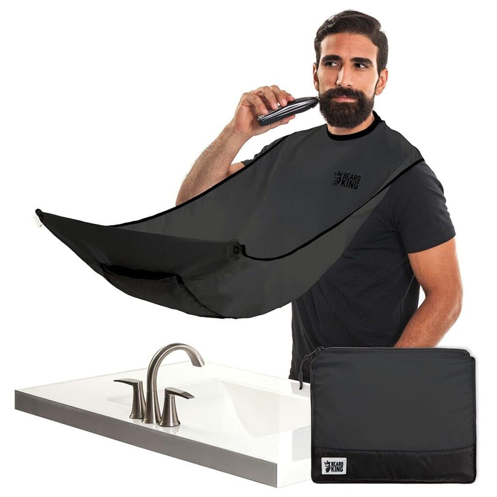 man trimming beard using beard king