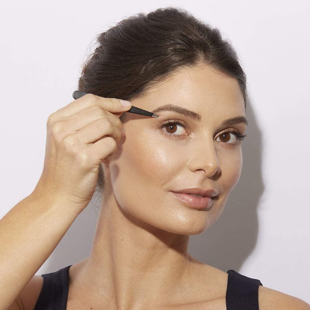 women using tweezers on brow