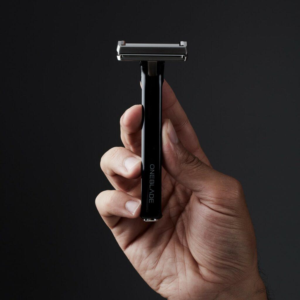 man holding razor in hand